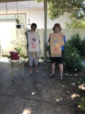 Rosenelle & Linda show off their embroidery work on garden flags - front