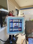 Elaine's nautical attic window quilt (she designed the paper pieced sailboat herself)