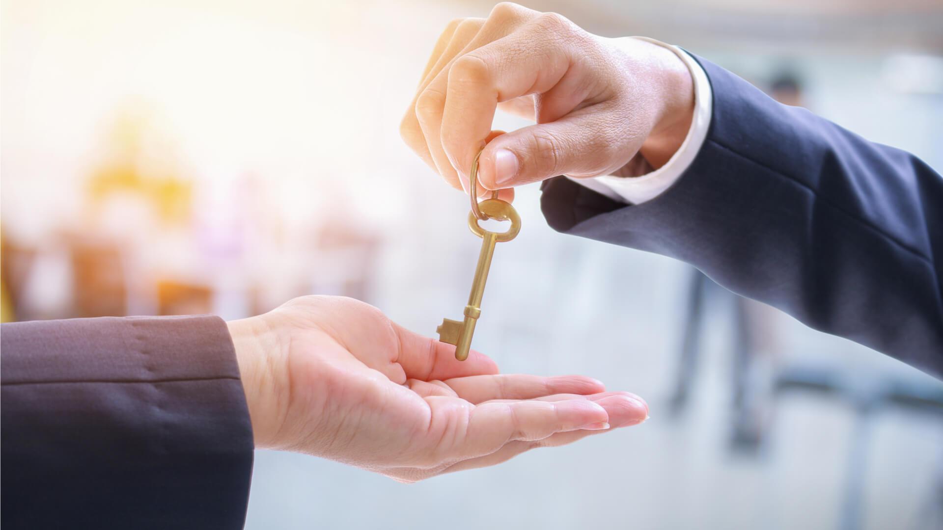 Advocate handing over a golden key
