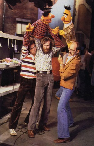 Richard Hunt (left), Jim Henson (center), and Frank Oz (right) performing Ernie and Bert, on the set of Sesame Street, 1970s. © Sesame Workshop