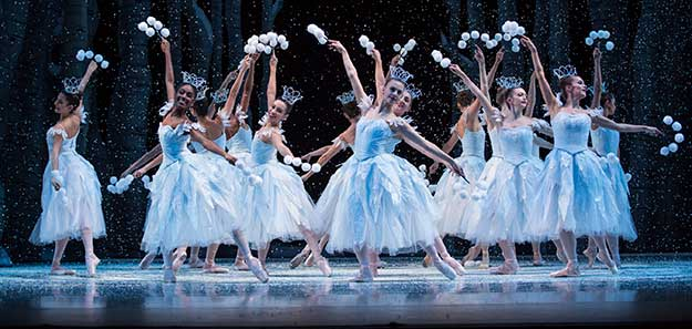 Pacific Northwest Ballet company dancers in the snow scene from George Balanchine's The Nutcracker®, choreographed by George Balanchine © The George Balanchine Trust. PNB's production features sets and costumes designed by children's author and illustrator Ian Falconer (Olivia the Pig) and runs November 24 – December 28, 2017. Photo © Angela Sterling.