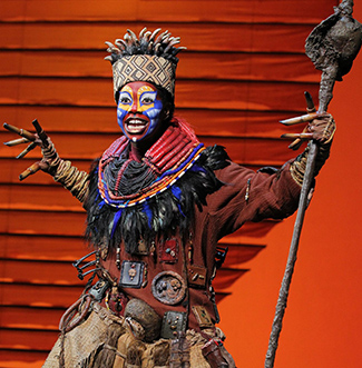 "Buyi Zama as ""Rafiki"" in ""TheLion King"" North American Tour. ©Disney. Photo by Joan Marcus"
