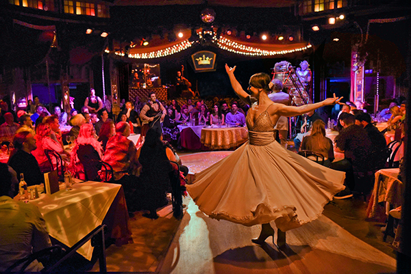 Elena Gatilova spinning at Teatro Zinzanni's Love, Chaos & Dinner