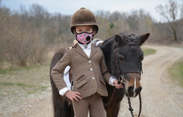 Wearing a Mask isn't Anything New For This 6-Year-Old Equestrian