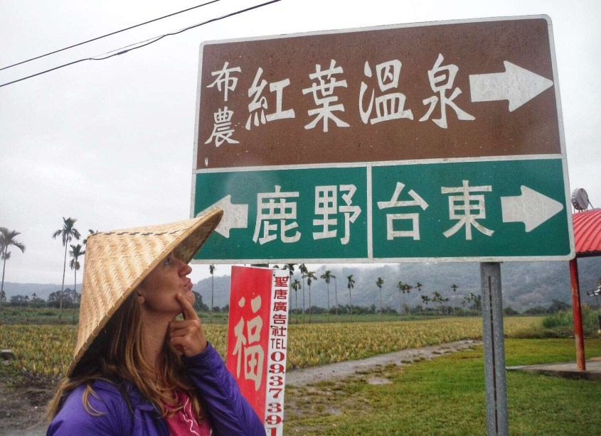 Krystal is wondering which way to go in Taiwan as she can't read the signs