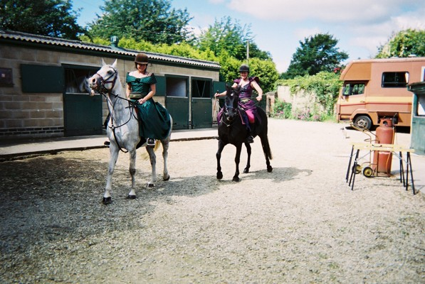Leaving the stables to go horse riding in dresses on the Ridgeway
