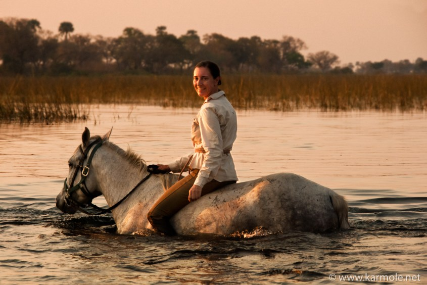 Riding bareback through a river in Botswana.