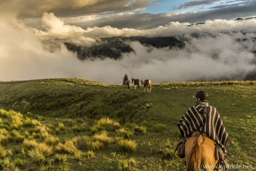 Light and clouds make a simple horseback riding scene magic in Ecuador