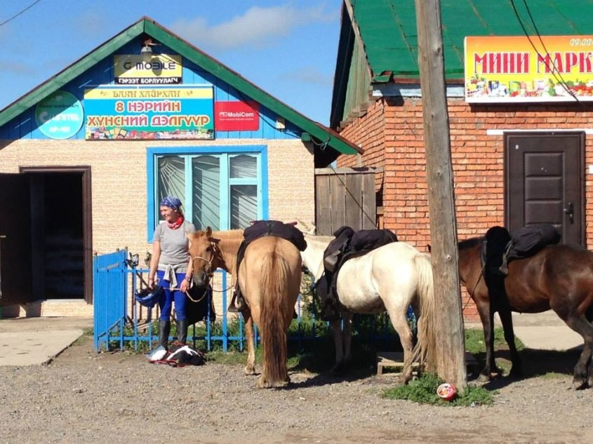 Shopping for groceries in a mongolian soum on horseback