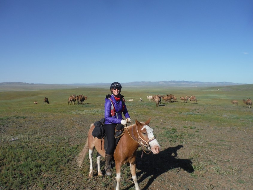 Riding the Mongol Derby on a slow horse - posing with camels! Mongol Derby Packing List