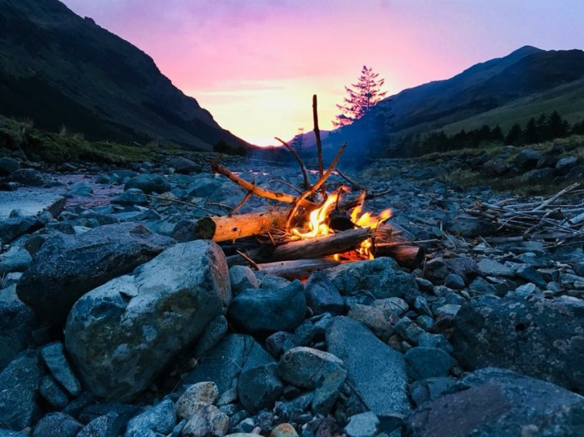 Campfire in a wild camping spot in Ennerdale while horse trekking through the Lake District in England