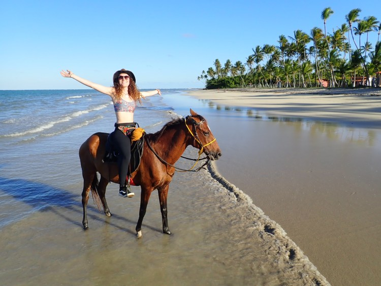 Feeling pure happiness during horse riding in Brazil on the beaches of Boipeba island