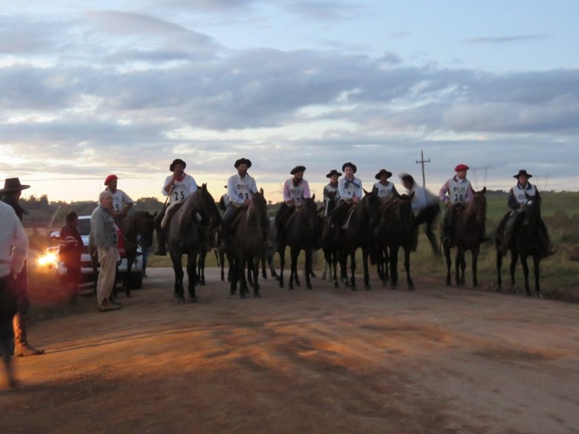 Riders at the start line for the Marcha da Resistência in Aceguá.