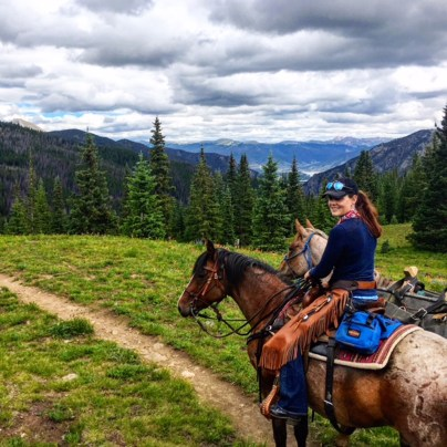 horse riding in Colorado on Salsa, a mean yet adorable mustang mare