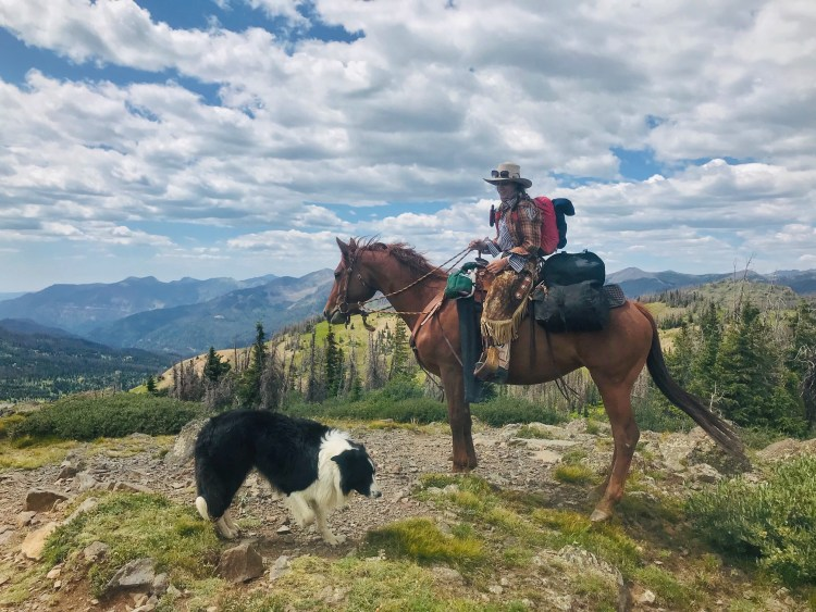 Equestrian Adventuress Jodie Morton is trail riding in the San Juan Mountains in Colorado with her horse all packed up and her dog joining her