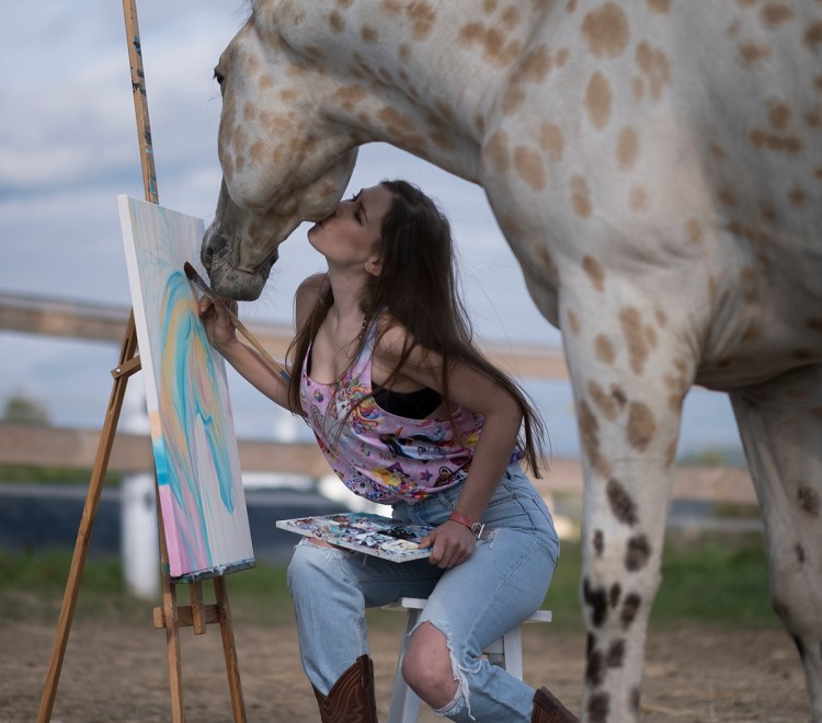 the healing power of horses unveils itself during painting horses in the paddock with them