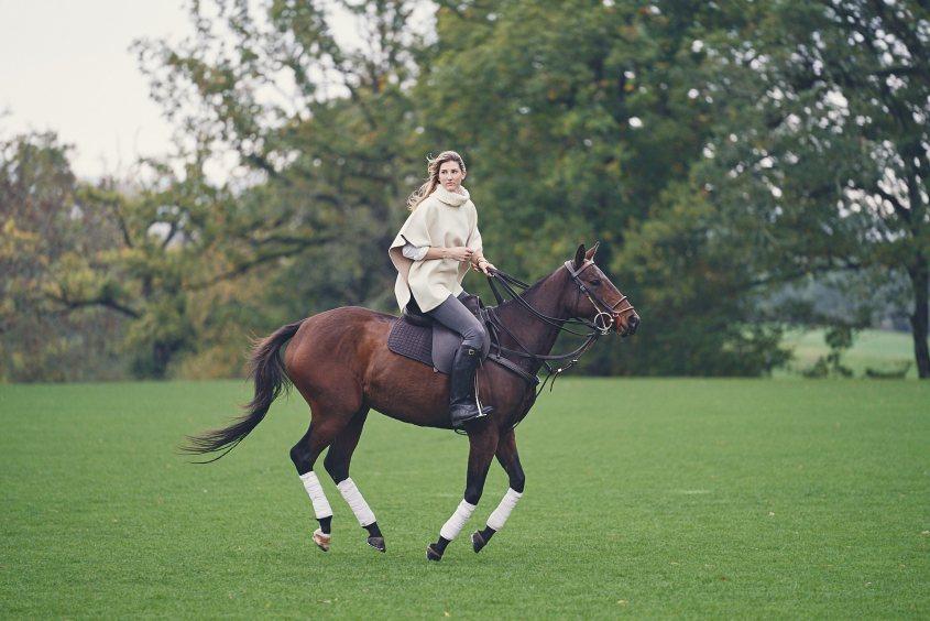 A woman polo player is riding a young horse produced by the well known Brazilian horse breaker Gabriel Santos for Henry Brett Polo.