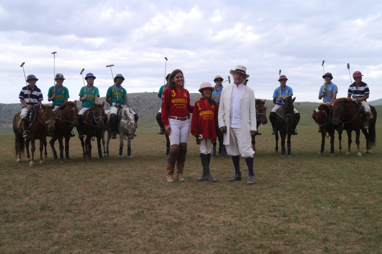 Players and horses posing for the camera at the Genghis Khan Polo Club in Summer 2015