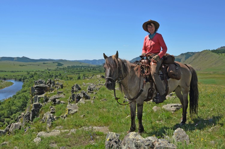 Mongolia on horseback: at a look out point above the Tuul River in Gorkhi Terelj National Park
