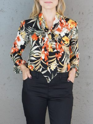 Floral workwear blouse with black pants