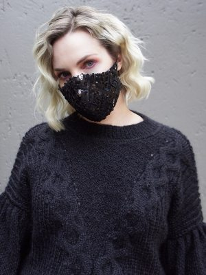 model wearing black knitted sweater and black beaded face mask South Africa