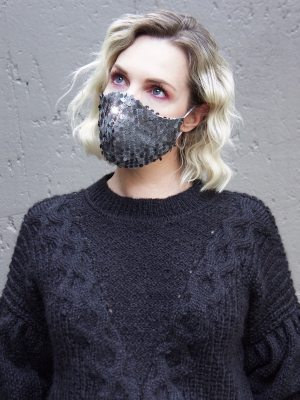 woman in silver grey sequins face mask and black knitted top South Africa