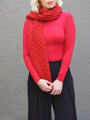 Model with red polo neck and red mohair scarf