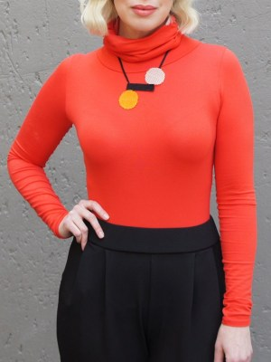 Zulu Love Letter Necklace on model with orange polo neck