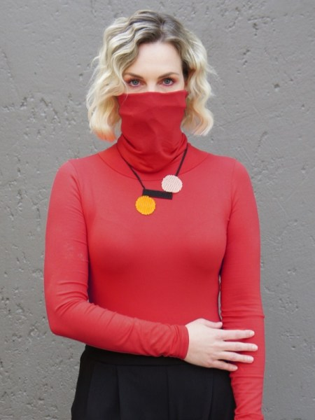 Woman wearing red polo neck with built-in face mask South Africa