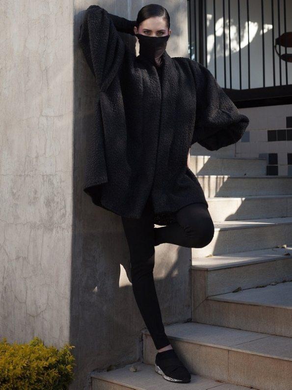Erre Textured Swing Coat Black Leaning Back
