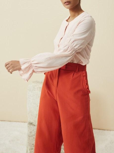 Pink hemp button down blouse with orange hemp pants South Africa