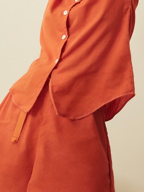 Asha Eleven Outlander Blouse Orange With Salama Shorts Closeup