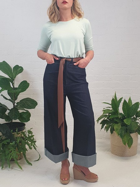 green T-shirt and wide leg jeans
