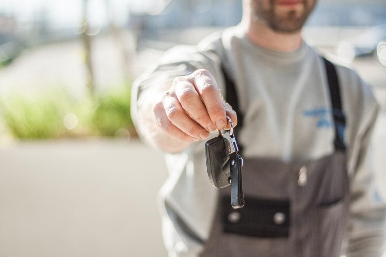 Man giving car keys