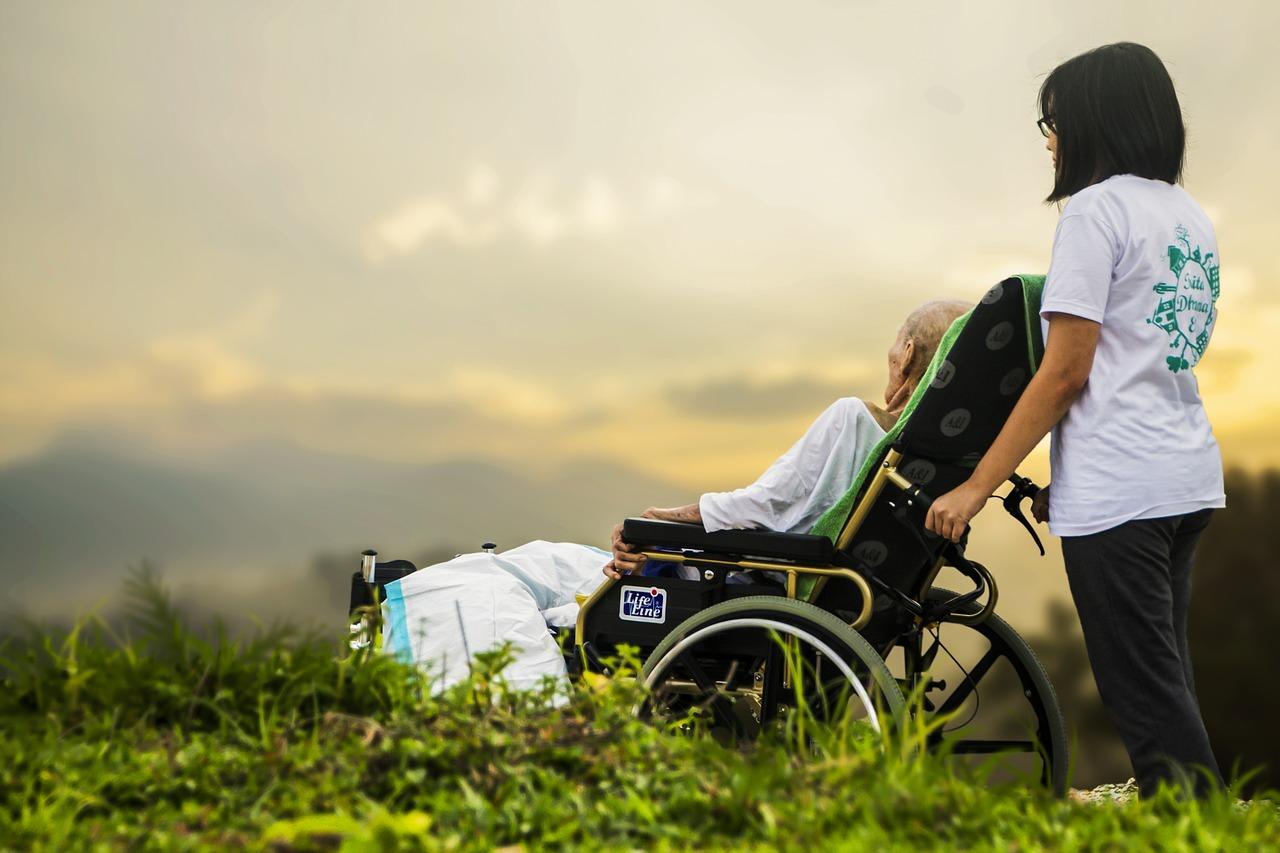 woman taking care of an elderly in monroe wheelchair