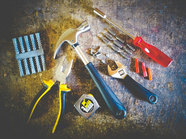 set of construction tools in floor