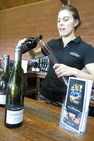 woman decanting wine