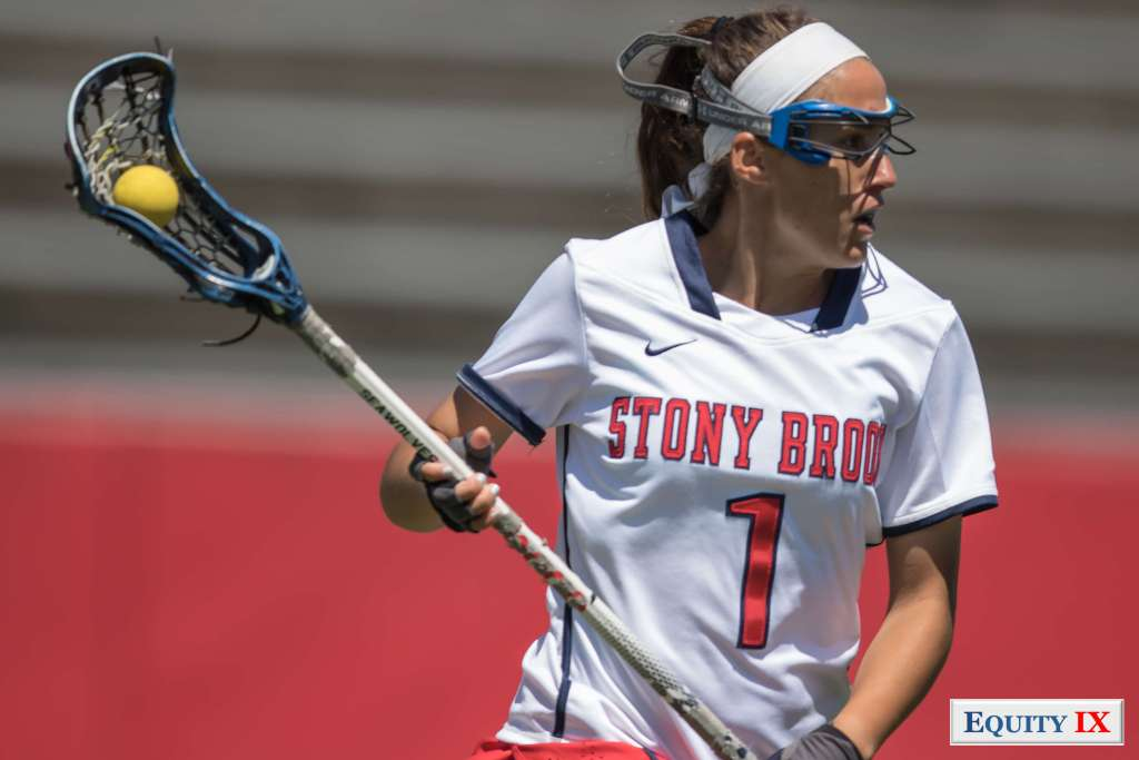 #1 Carolyn Carrera - Stony Brook - NCAA Women's Lacrosse is top defender cradles lacrosse ball with a white headband, goggles and bandage lacrosse her nose for a head injury © Equity IX - SportsOgram - Leigh Ernst Friestedt