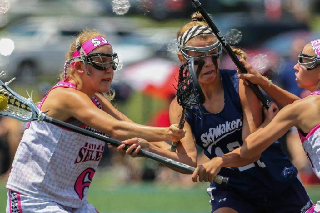 Skywalker girls lacrosse attacker tried to shoot the ball with two defenders from Jersey Select checking lacrosse her body © Equity IX - SportsOgram - Leigh Ernst Friestedt