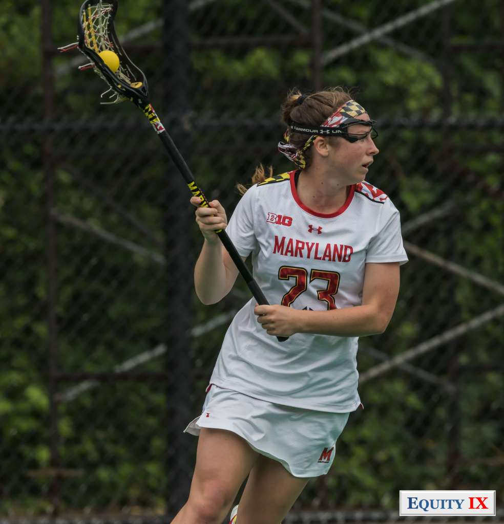 #23 Megan Whittle - Maryland - 2017 NCAA Women's Lacrosse Champions - cradles the ball right handed with goggles and a Maryland striped headband © Equity IX - SportsOgram - Leigh Ernst Friestedt