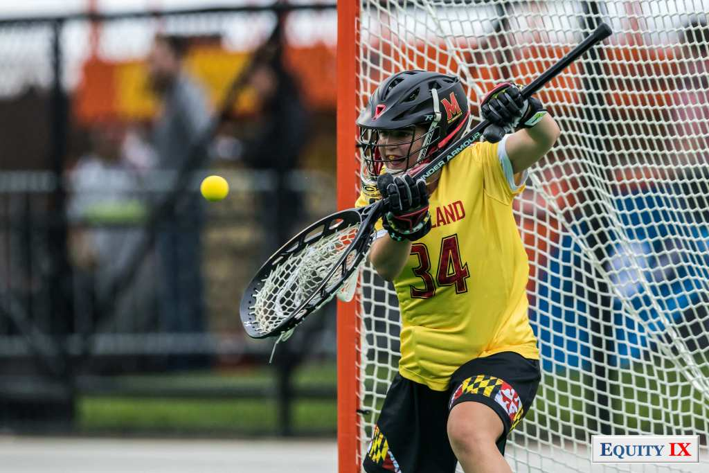 #34 Megan Taylor - Maryland Women's Lacrosse Goalie stops a shot with bright yellow jersey and helmet - 2017 NCAA Champions © Equity IX- SportsOgram - Leigh Ernst Friestedt