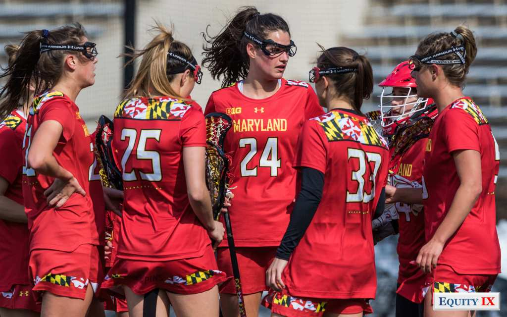 #24 Julia Braig and other top Maryland women's lacrosse defenders huddle together in red jerseys after a goal - Maryland Women's Lacrosse Defense 2018 - NCAA Women's Lacrosse - Equity IX - Early Recruiting - SportsOgram - Leigh Ernst Friestedt - ZyGoSports