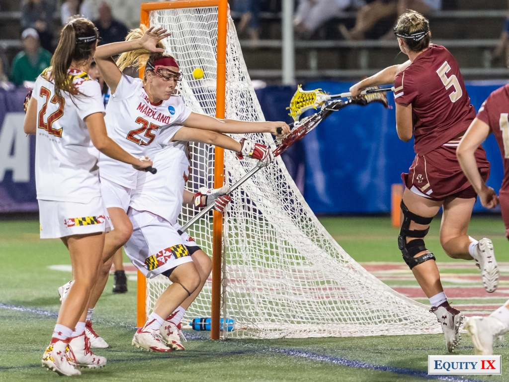 "#5 Tess Chandler (Boston College) at 6'0"" wearing a knee brace on her left shoots the ball right handed from behind Maryland's lacrosse goal - Maryland goalie Megan Taylor is ducking in cage and #25 Maryland defense is diving lacrosse the goal to stop the ball with her eyes closed - 2018 NCAA Women's Lacrosse Final Four © Equity IX - SportsOgram - Leigh Ernst Friestedt"
