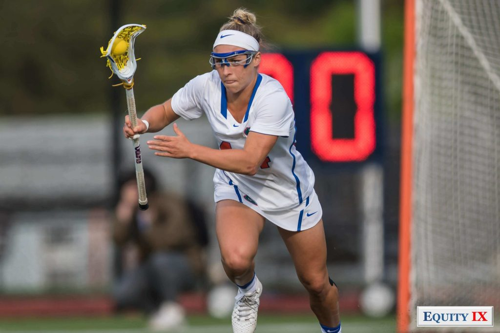 #44 Sydney Pirreca - Florida Gators runs down the field cradling lacrosse yellow ball with right hand, goggles and Nike white headband - 2017 NCAA Women's Lacrosse - Big East Champions © Equity IX - SportsOgram - Leigh Ernst Friestedt - ZyGoSports
