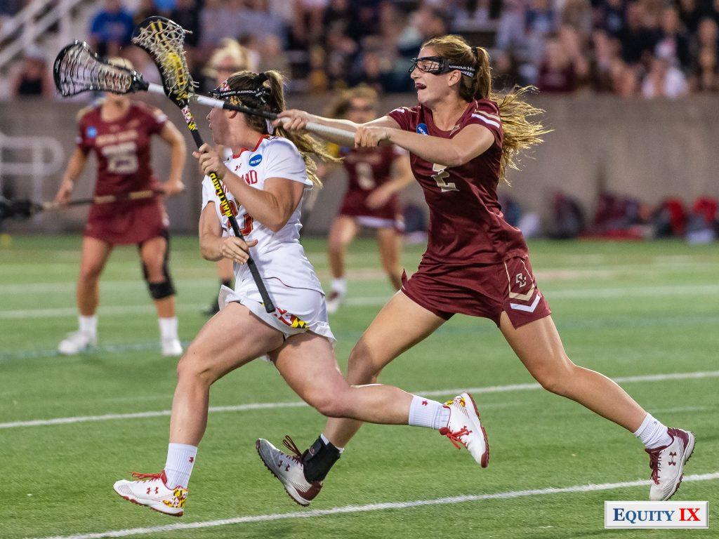 Sam Apuzzo (Boston College #2) checks ball away from Megan Whittle (Maryland #23) cradling left handed at 2018 NCAA Women's Lacrosse Championship - Tewaaraton Award © Equity IX - SportsOgram - Leigh Ernst Friestedt