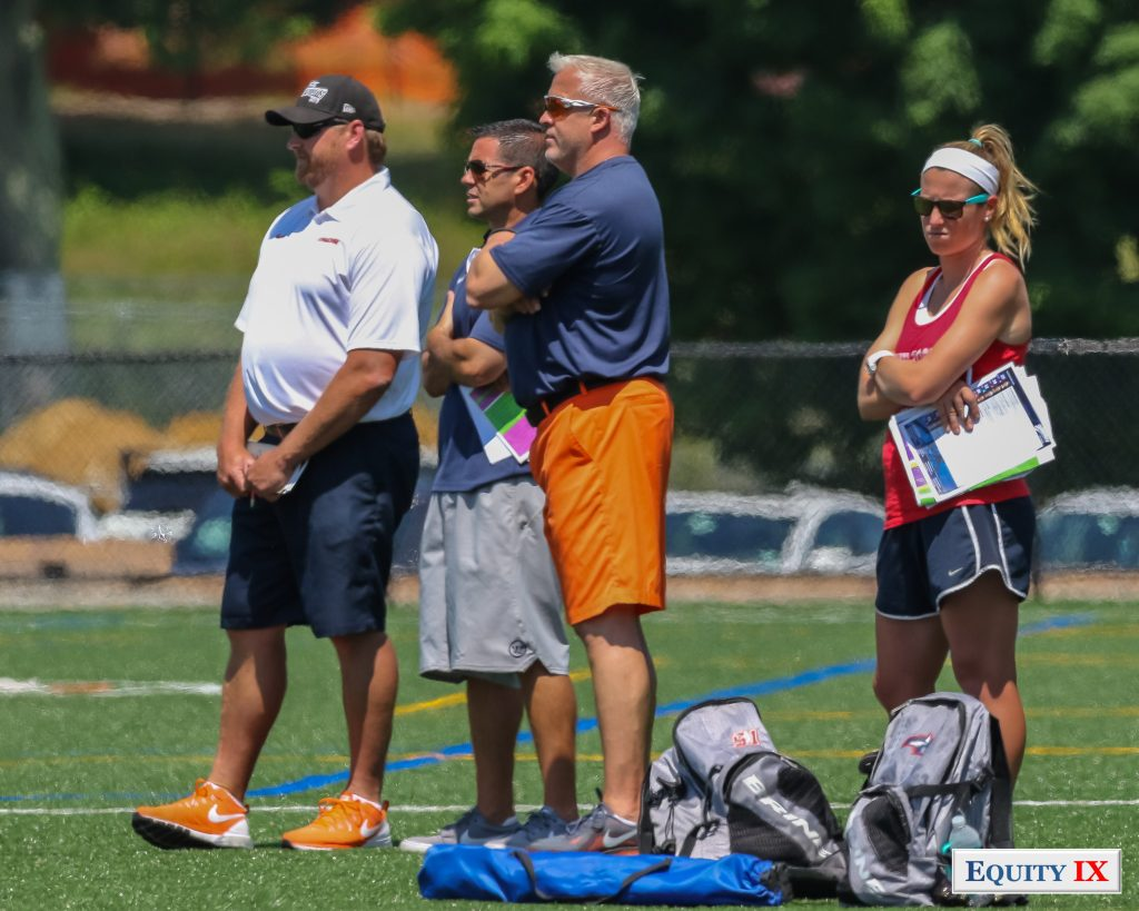 Gary Gait (Syracuse) and Joe Spallina (Stony Brook) top college women's lacrosse coaches watch club girls lacrosse with sunglasses for early recruiting at 2015 Nike Elite G8 Tournament © Equity IX - SportsOgram - Leigh Ernst Friestedt
