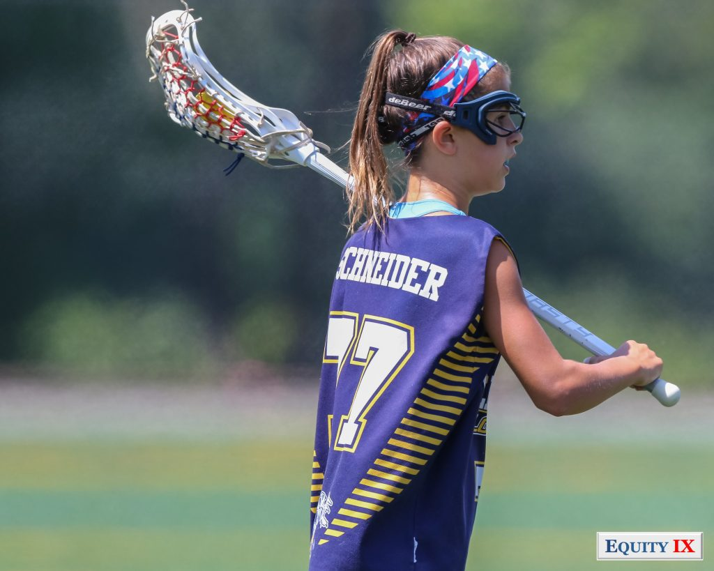 #77 Schneider throws lacrosse ball left handed in yellow jackets purple and yellow tank top with goggles and red, white and blur headband - 2015 Girls Club Lacrosse - Nike Elite G8 - Yellow Jackets © Equity IX - SportsOgram - Leigh Ernst Friestedt