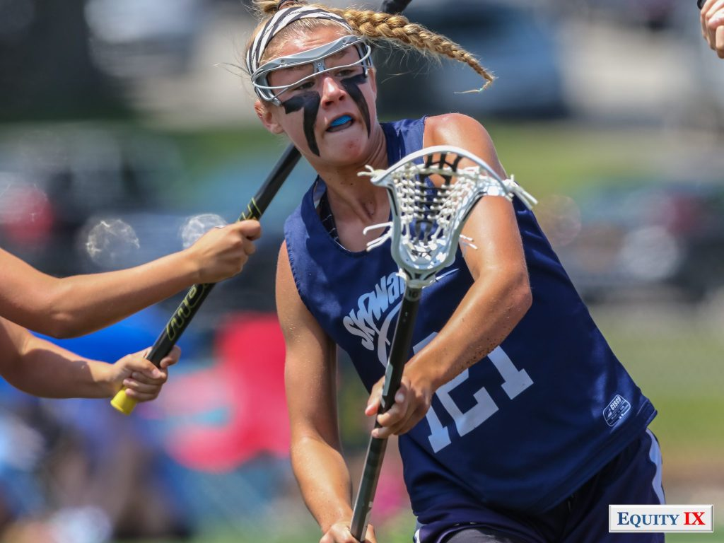 Early recruit #121 Skywalker shoots the lacrosse ball left handed in her navy blue tank top with eye black, a blue mouthguard, goggles and a braid - 2015 Girls Club Lacrosse - Nike Elite G8 Tournament © Equity IX - SportsOgram - Leigh Ernst Friestedt