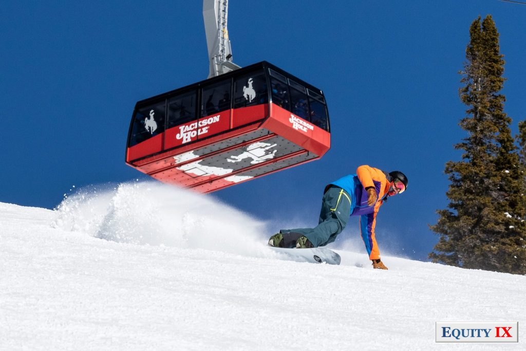 Matt Friestedt snowboarding in Jackson Hole with the tram coming over the ski slop © Equity IX - SportsOgram - Leigh Ernst Friestedt