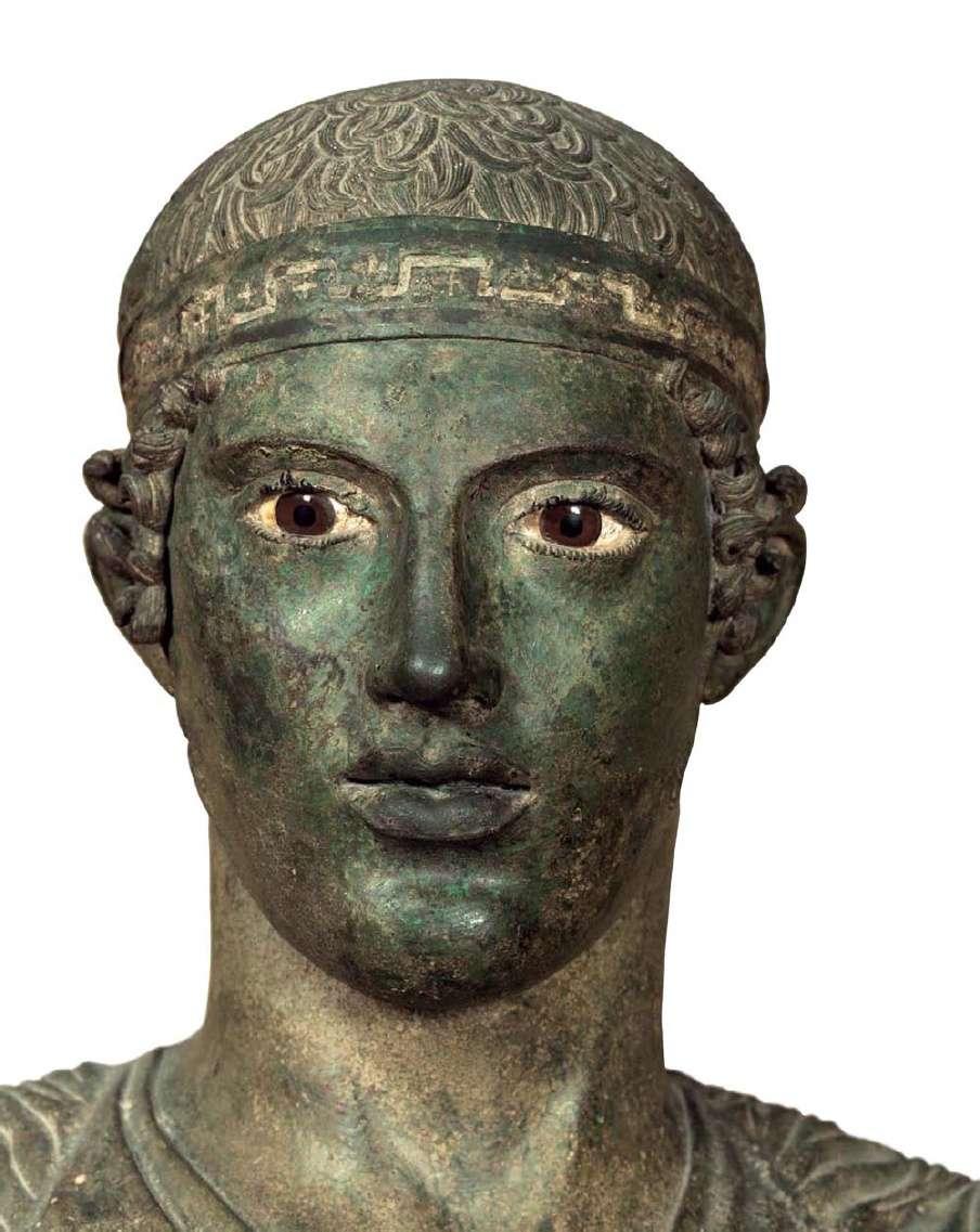 Το κεφάλι του Ηνιόχου, του νέου που οδήγησε στη νίκη το άρμα ενός άρχοντα της Σικελίας. 470 π.Χ. Αρχαιολογικό Μουσείο Δελφών.